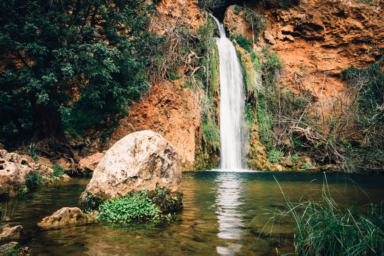 water, waterfall, beauty in nature, rock, scenics - nature, rock - object, solid, plant, tree, forest, flowing water, long exposure, motion, nature, rock formation, land, non-urban scene, flowing, waterfront, no people, outdoors, falling water, power in nature, rainforest