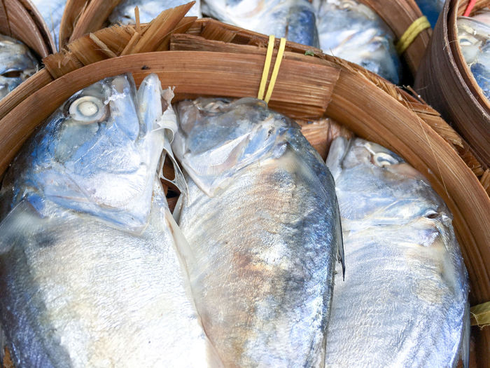 Top view closeup mackerel fishes in bamboo baskets at the food store in fresh market