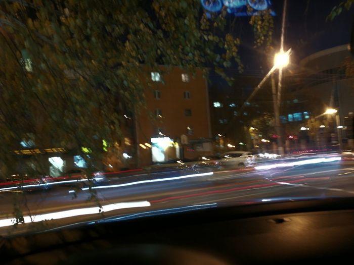City Cityscape Illuminated Street Light Long Exposure Light Trail Car Speed Blurred Motion Motion Tail Light Vehicle Light Traffic Circle Highway Headlight Traffic Rush Hour Elevated Road Stoplight Multiple Lane Highway