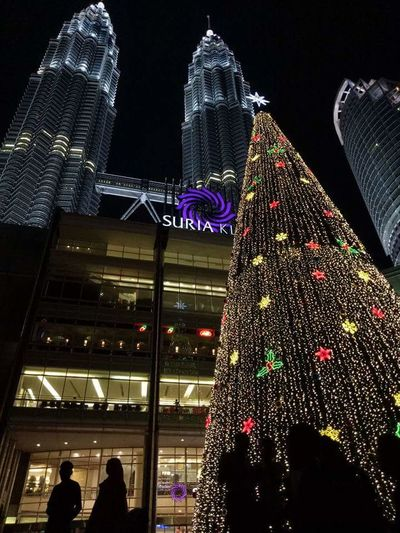 Suria KLCC Nightphotography Night Architecture Illuminated Built Structure City Low Angle View Building Exterior Nightlife Modern Skyscraper Motion People Outdoors Sky Malaysia