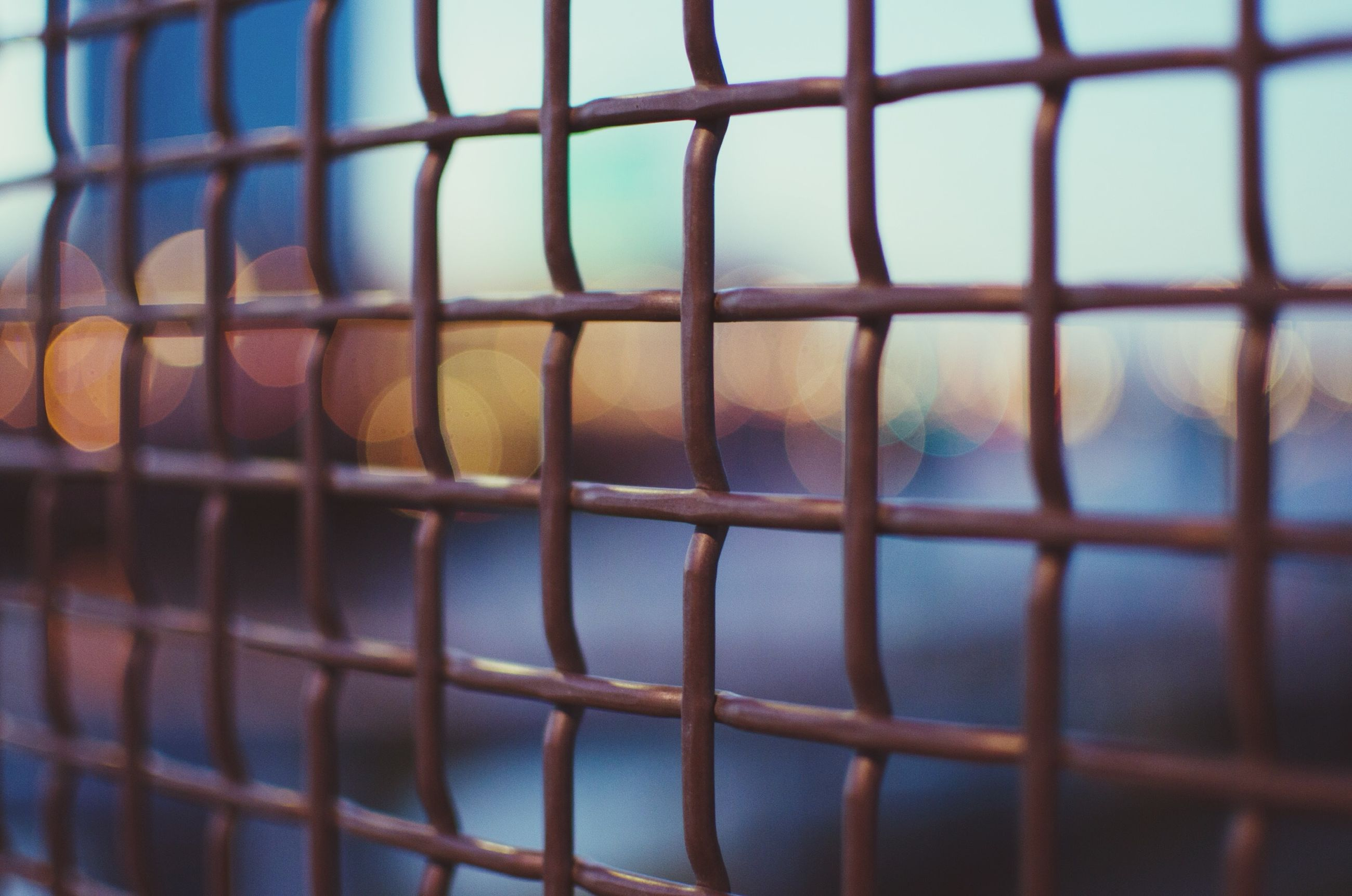 full frame, backgrounds, pattern, architecture, built structure, indoors, window, metal, building exterior, metal grate, glass - material, geometric shape, fence, design, modern, focus on foreground, close-up, repetition, no people, day