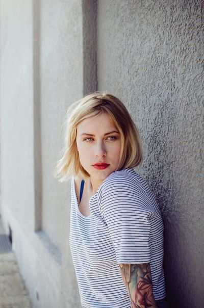 Looking At Camera Portrait Blond Hair Young Adult Beautiful Woman One Person Young Women Confidence  Casual Clothing Front View Day Standing Beauty Architecture Beautiful People Outdoors Red Lipstick Adult One Young Woman Only Close-up