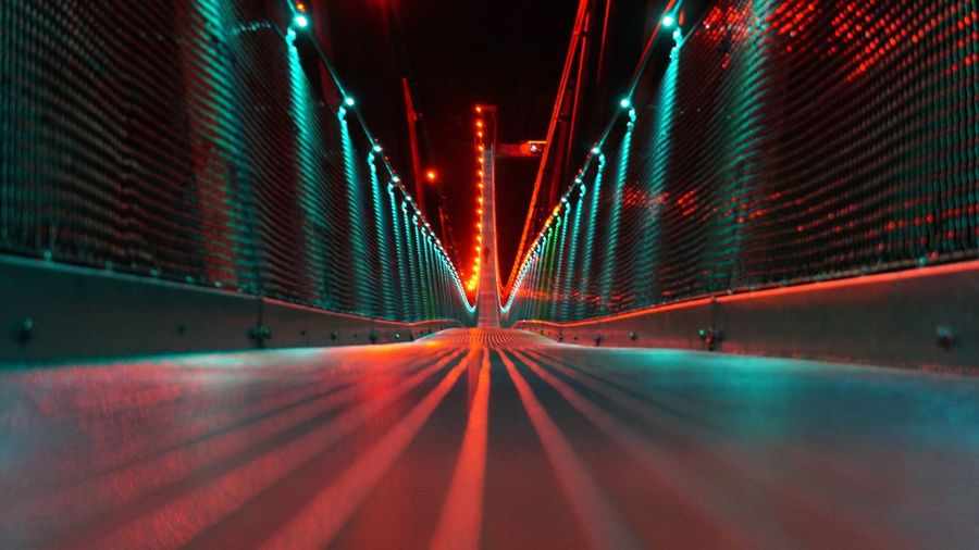 Surface Level View Of Illuminated Bridge At Night