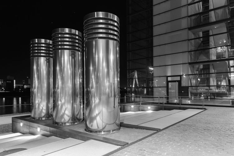 Cologne by night #1 Architecture Black And White Black And White Photography Bridge Building Exterior Built Structure City City Lights Cologne Columns Columns And Pillars Harbor Harbourside Illuminated Metal Metallic Mirror Modern Night No People Reflection Reflections Sky Waterfront The Architect - 2017 EyeEm Awards