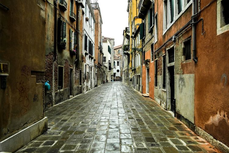 Venice - March 2015 Reflection Wet Street Cobblestone Europe Italy Venice Architecture Building Exterior Built Structure The Way Forward Residential Building Alley Street Window Day Outdoors City No People Sky