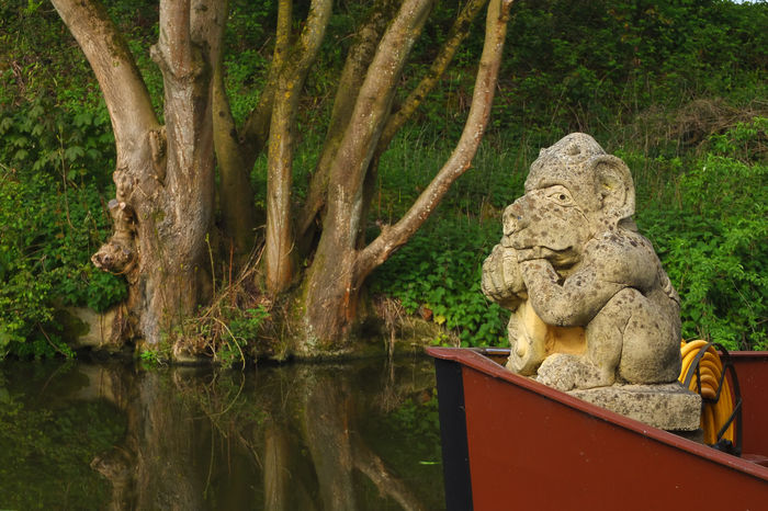 Beauty In Nature Canal Boat Canals And Waterways EyeEmNewHere Garden Ornament Gargoyle Kennet And Avon Canal Liveaboard Lookout Nature No People Off Grid Sculpture Stone Ornament