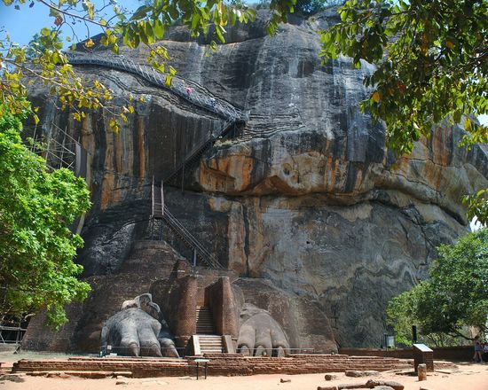 sigiriya Sri Lanka Sigriya Rock Place Where Sita Was Held Captive King Ravana's Palace Sigriya Sigiriya, Sri Lanka,Asia,Travel,Explore, Traveler, Lion Rock, Sigiriya Sigiriya Rock Tree Ancient Civilization Spirituality Religion Statue Architecture Building Exterior Built Structure
