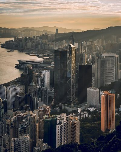 Hong Kong Skyscraper Cityscape Architecture City Building Exterior Urban Skyline Sunset Built Structure Travel Destinations Tower High Angle View Aerial View Modern Outdoors Downtown District Development Growth Scenics Stories From The City The Traveler - 2018 EyeEm Awards