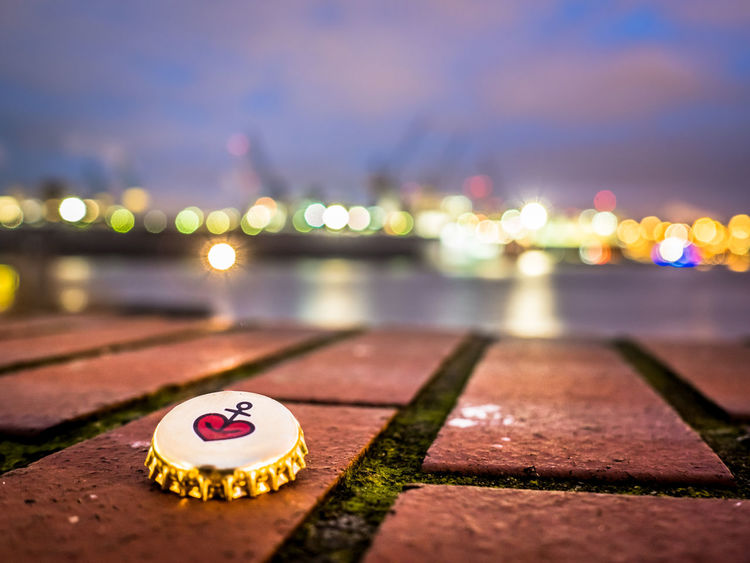 From Hamburg with Love / Hafenliebe Blurred Bottle Cap Brick Wall Cranes Elbe River Harbor Industry Lights Riverside Anchor Blue Sky Blurred Background Brick Capsule Close-up Elbe Focus On Foreground Heart Illuminated Night No People Outdoors Sky Water Waterfront