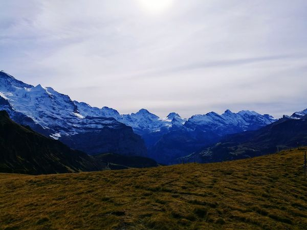 Landscape Mountain Mountain Range Hiking Scenics Beauty In Nature Cloud - Sky Nature Mountain Peak Outdoors Sky Switzerland Ice Physical Geography Grass Sun Cold Temperature Snow Nature Switzerland Alps