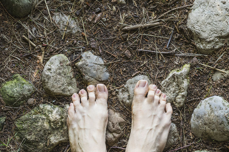 barefoot Body Part Day Directly Above Dirt High Angle View Human Body Part Human Foot Human Leg Human Limb Land Leisure Activity Lifestyles Low Section Nature One Person Outdoors Personal Perspective Plant Real People