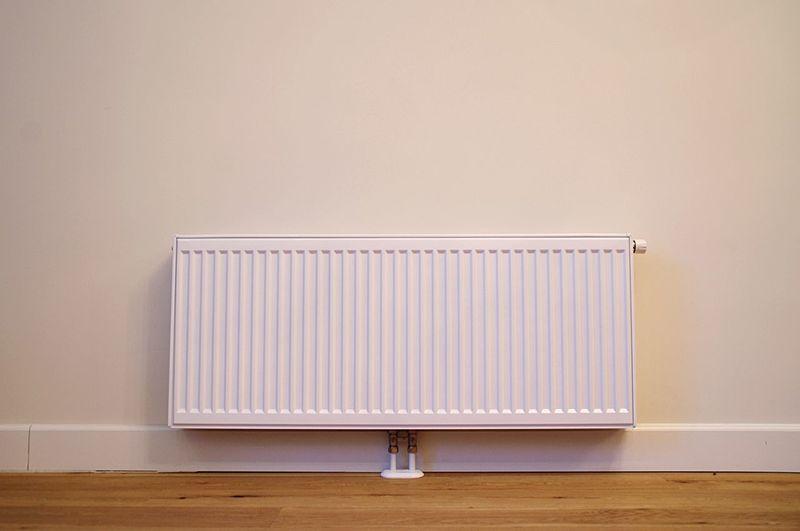 Radiator on an empty wall Saving Ecology Energy Heater Warmth No People Indoors  Hardwood Floor Radiator Home Interior