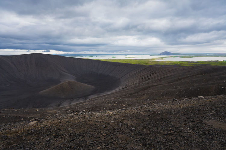 View of the myvatn lake from the rim of hverfjall volcano in northern iceland on a cold, cloudy day.