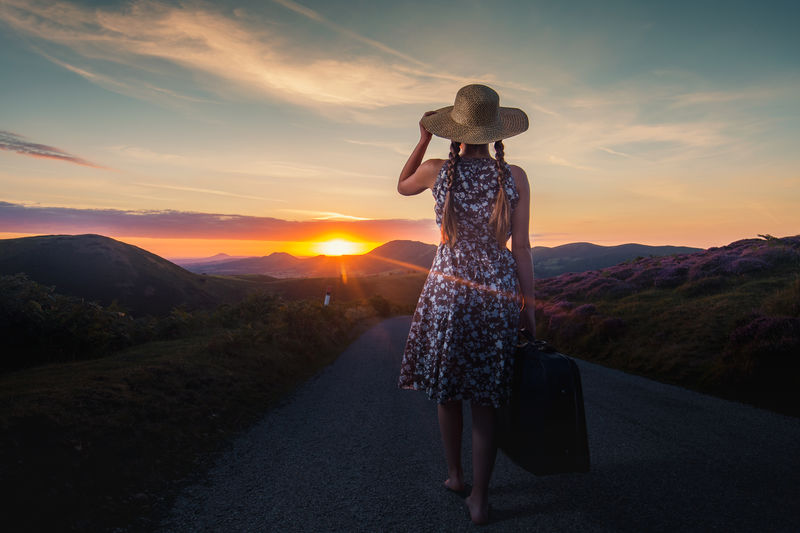 Summer Walks Travel Adventure Barefoot Beauty In Nature Cloud - Sky Full Length Landscape Leisure Activity Lifestyles Mountain Nature One Person Outdoors Real People Rear View Scenics Sky Standing Suitcase Summer Sun Beams Sunlight Sunrise Women Young Women