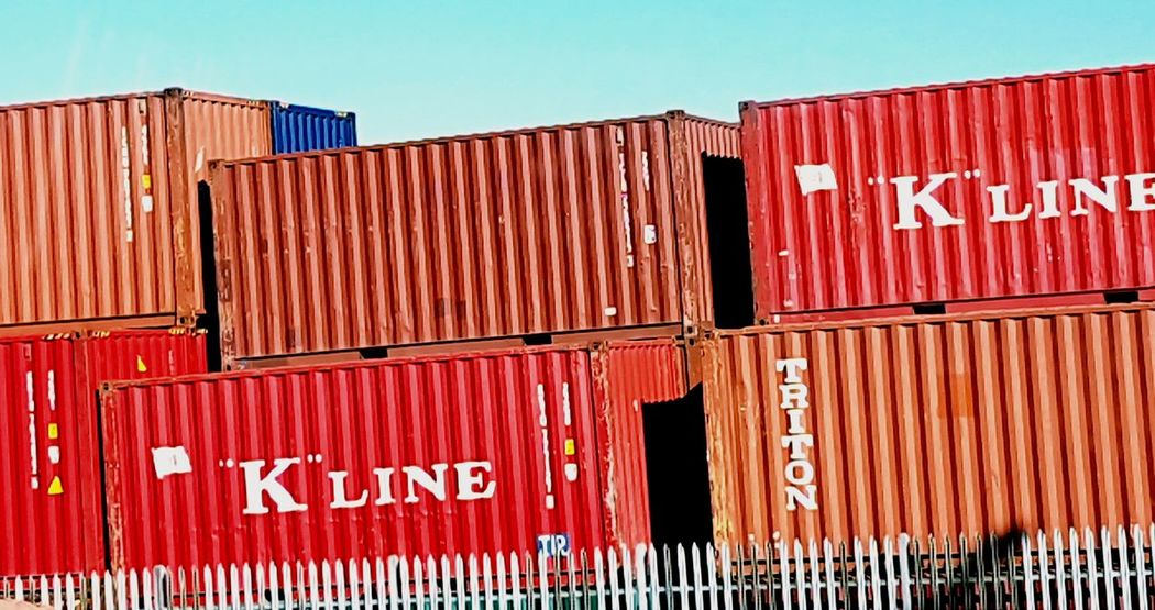 Shades And Tones. Red Outdoors Clear Sky Cargo Container Commercial Dock Sunlight Shipping  Industry Corrugated Corrugated Iron No People Sky Blue Sky Background Coloursareeverywhere Low Angle View Colour Of Life