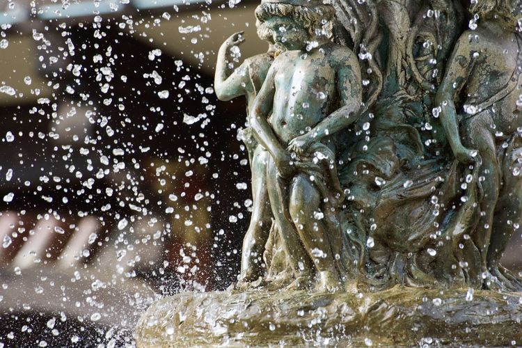 Close-up of water drops on fountain