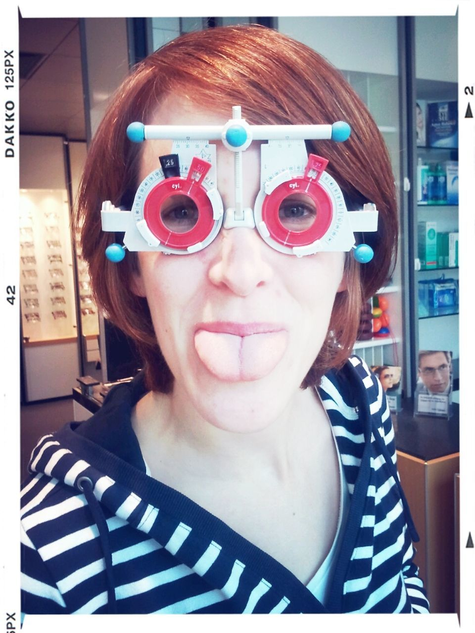 Portrait Of Woman Wearing Eye Test Equipment At Clinic
