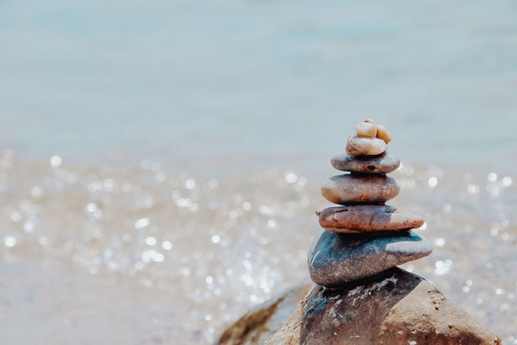 Stack of stones on beach. concept of equillibrium.
