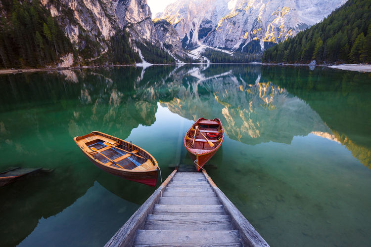 Boat on lake by mountains