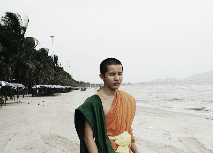 Monk Novice Travel Photography Beach Beauty In Nature Buddhism Casual Clothing Clear Sky Leisure Activity Lifestyles Men Monk  Nature Novice Monk One Person Outdoors People Real People Sand Sea Sky Standing Tree Vacations Young Adult Fresh On Market 2017