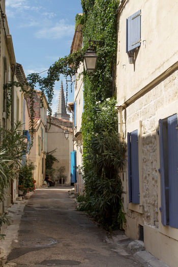 A narrow street at Arles, France Architecture Building Exterior Built Structure Day Empty Footpath House Long Narrow No People Old Town Outdoors Plant Residential Structure Sky Street The Way Forward Tourism Town Travel Destinations Window