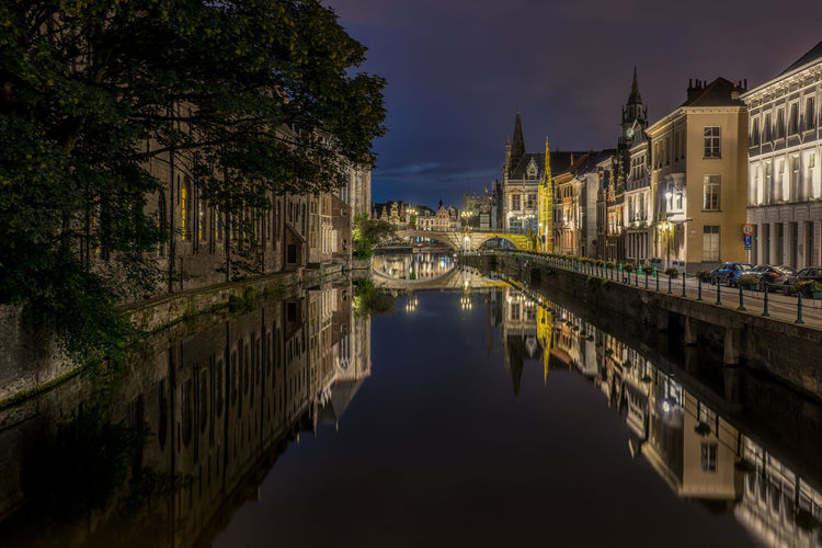 SCENIC VIEW OF ILLUMINATED OLD TOWN AND CANAL AT NIGHT