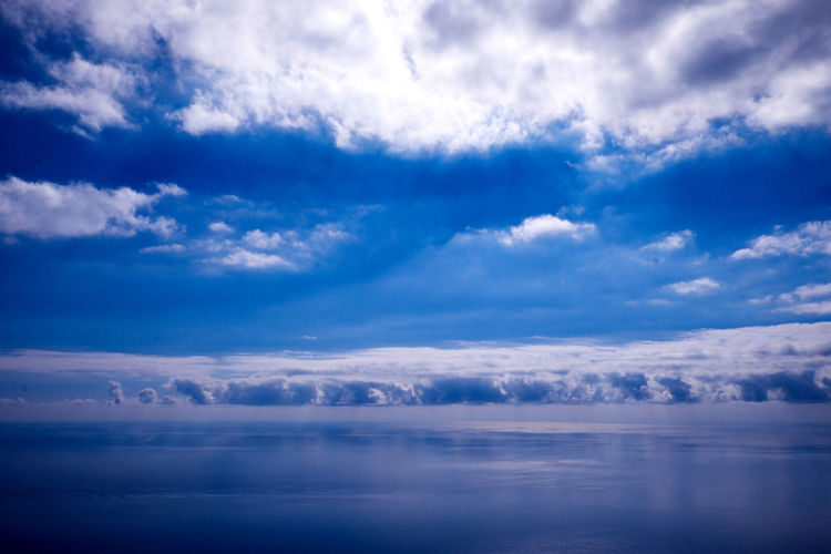 Sea Cloud - Sky Sky Scenics - Nature Beauty In Nature Tranquility Tranquil Scene Blue Nature No People Water Day Outdoors Idyllic Environment Cloudscape Horizon Horizon Over Water Meteorology