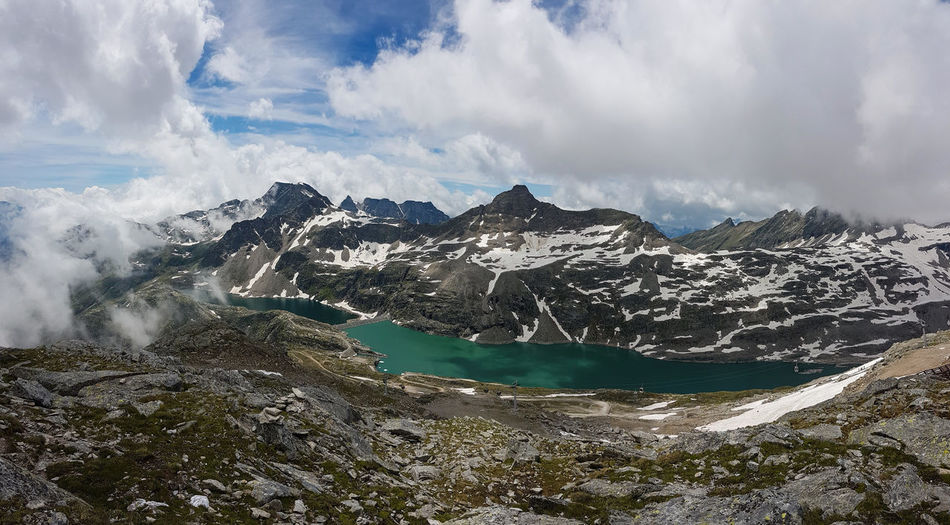 Panoramic view of snowcapped mountains and lake in austria