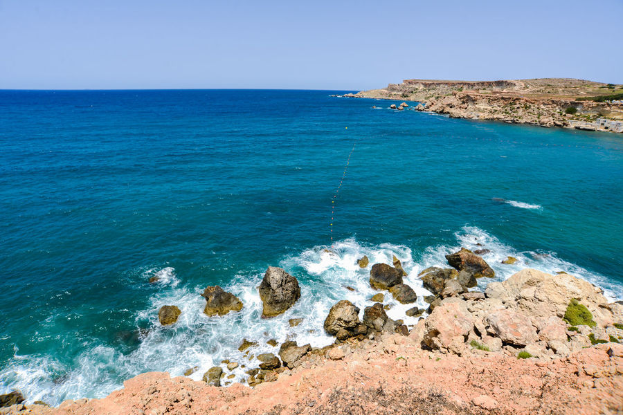 Cactus Hotels Malta Vacations Beach Beauty In Nature Blue Blue Water Bluse Sea Clear Sky Cliff Day Golden Bay Horizon Over Water Maltaphotography Maltese Nature No People Outdoors Rock - Object Scenics Sea Sky Tranquil Scene Tranquility Travel Destinations Troy Turism Water Wave Waves
