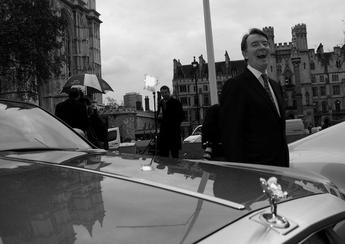 Peter Mandelson tries luxury vehicles during a automotive industry trade conference at the QEII Centre while hundreds of protesters and relatives of dead soldiers demanded the civil arrest of Tony Blair during the Iraq War enquiry in the same location. The Photojournalist - 2016 EyeEm Awards Demonstrations  Protesters Uk London Photojournalism Iraq War Enquiry