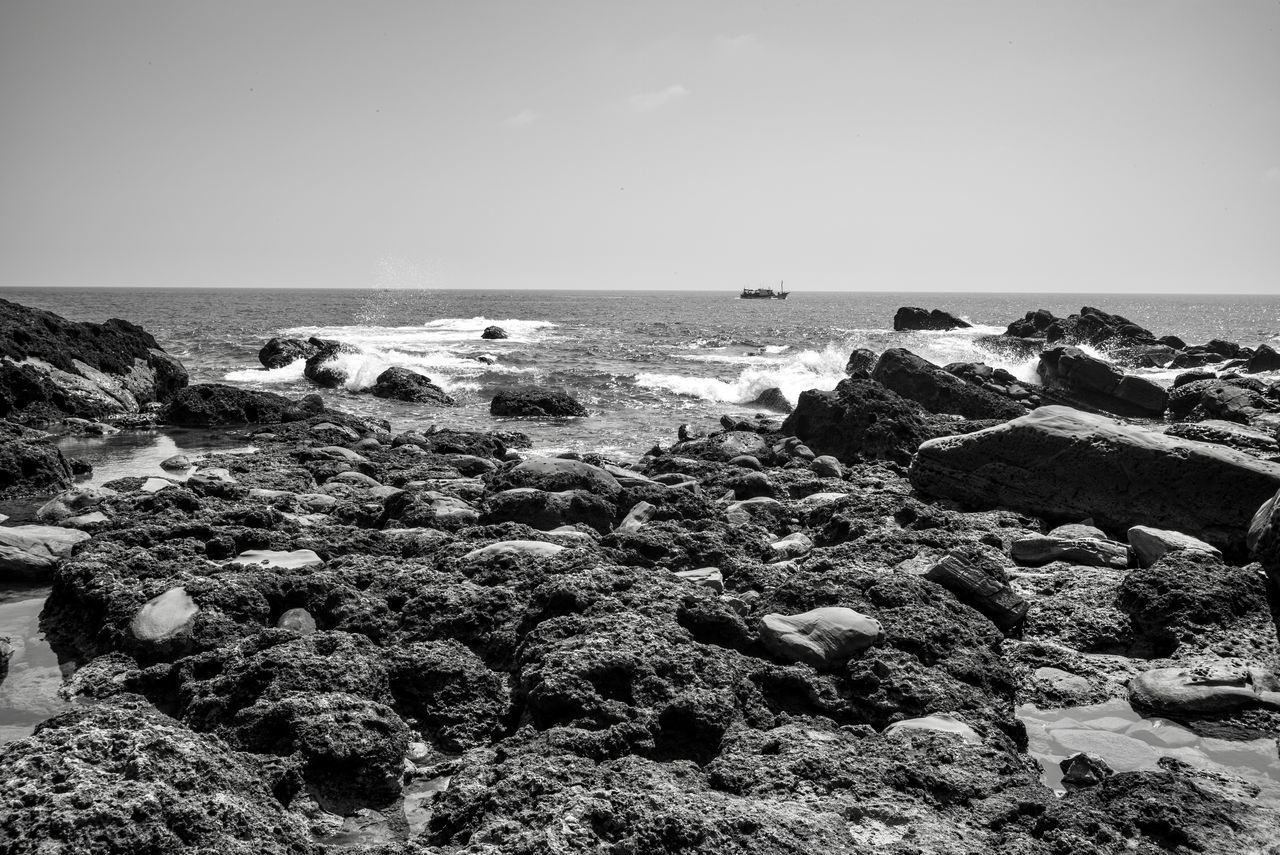 water, sea, sky, horizon, rock, horizon over water, beach, land, solid, rock - object, beauty in nature, scenics - nature, nature, day, tranquility, tranquil scene, no people, clear sky, copy space, outdoors, rocky coastline, marine