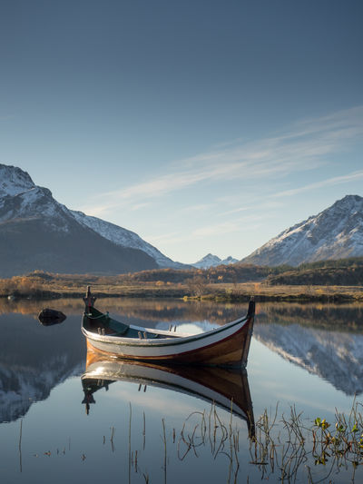 Beauty In Nature Boat Day Lake Landscape Mode Of Transport Moored Mountain Mountain Range Nature Nautical Vessel No People Norway Outdoors Reflection Reflection Rowing Boat Scenics Sky The Great Outdoors - 2017 EyeEm Awards Tranquil Scene Tranquility Transportation Vesterålen Water Lost In The Landscape