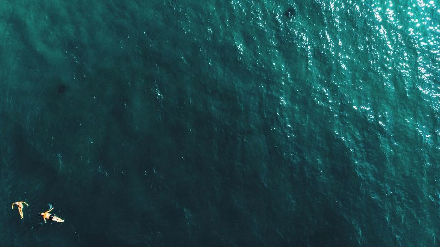 Aerial View Of Man And Woman On Swimming In Sea