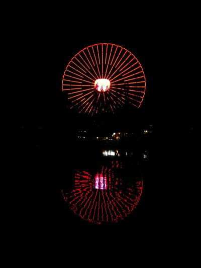 reflection light at Mirabilandia Circle Night Illuminated Arts Culture And Entertainment Ferris Wheel No People Red Amusement Park Multi Colored Outdoors Black Background Celebration Going Remote Visual Creativity The Creative - 2018 EyeEm Awards Humanity Meets Technology