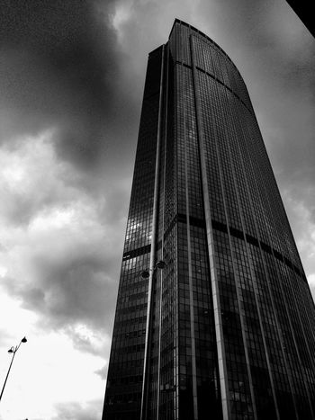 Skyscaper in Paris, France Low Angle View Sky Architecture Built Structure Outdoors No People Cloud - Sky Building Exterior City Day Skyscraper Modern Blackandwhite Architecture Minimalism EyeEmNewHere The Architect - 2017 EyeEm Awards