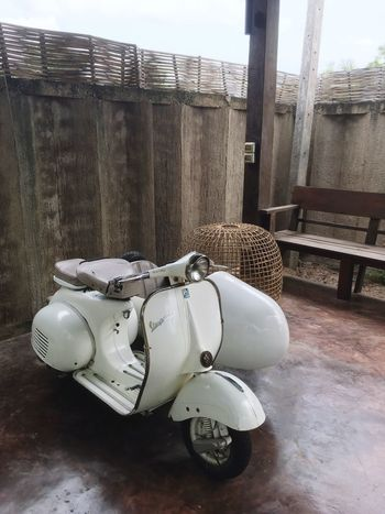 Scooter Vespavintage Vespa No People Day Wood - Material Mode Of Transportation Transportation Security Metal Outdoors Protection Built Structure Nature Technology Architecture Weapon High Angle View Safety