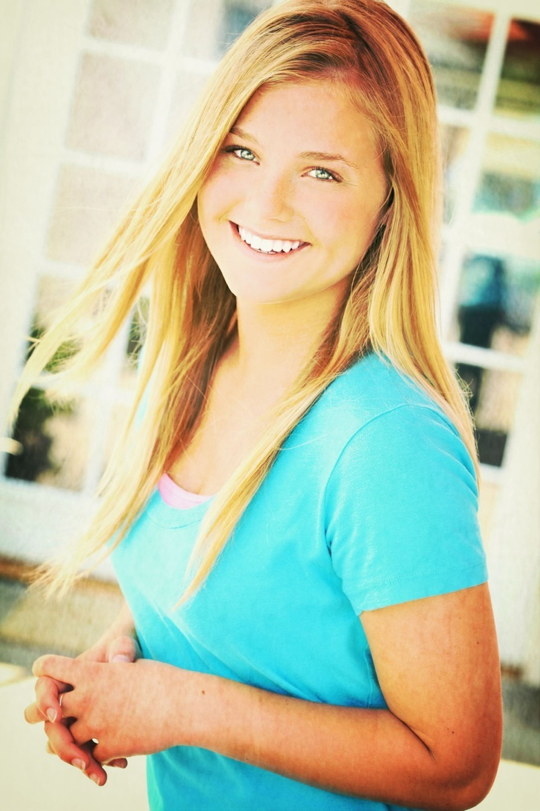 person, lifestyles, casual clothing, portrait, leisure activity, smiling, looking at camera, front view, waist up, happiness, childhood, focus on foreground, elementary age, young adult, three quarter length, blond hair, headshot