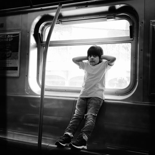 Javier Vehicle Interior Transportation Train - Vehicle Window Public Transportation Real People One Person Mode Of Transport Full Length Sitting Vehicle Seat Casual Clothing Childhood Lifestyles Journey Elementary Age Boys Day Subway Train Commuter Train The Street Photographer - 2017 EyeEm Awards EyeEm Best Shots - Black + White New York City NYC EyeEm Best Shots