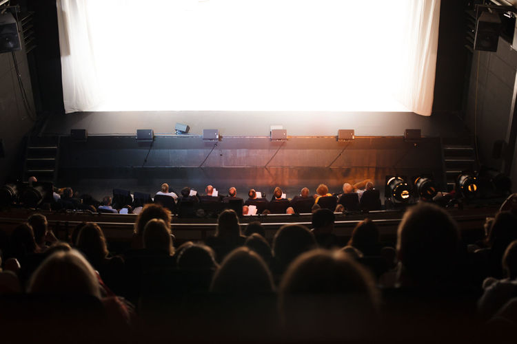 people at the theater Theater Stage Audience People Watching Play Show Public Sitting Performance Arts Culture And Entertainment Auditorium Event Fesitival Lifestyle Indoors  Comedy Drama Concert Premiere White Space Spectators Musical Classical