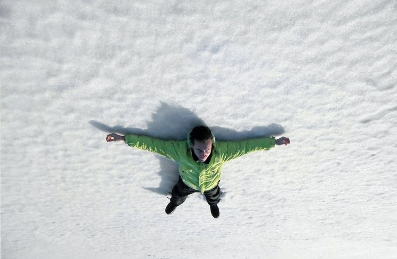 High angle view of man with arms outstretched
