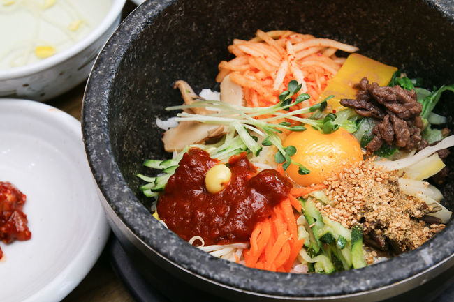Dolsot bibimbap, a korean mixed rice meal prepared in a hot stone bowl. Bibimbap Cuisine Korean Korean Food Meal Rice Bowl Colorful Dolsot Dolsotbibimbap Fresh Gochujang Mixed Popular Stone Vegetables