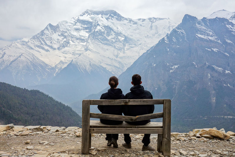 Himalayas Adult Beauty In Nature Bench Bonding Couple - Relationship Leisure Activity Lifestyles Looking At View Love Men Mountain Mountain Range Nature Outdoors People Positive Emotion Real People Rear View Scenics - Nature Seat Sitting Togetherness Two People