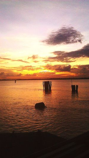 Sunset from the world largest floating bridge. Going Places ♥  Check This Out PhonePhotography Sunset Water Beauty In Nature Nature Sky Tranquility Outdoors No People Horizon Over Water