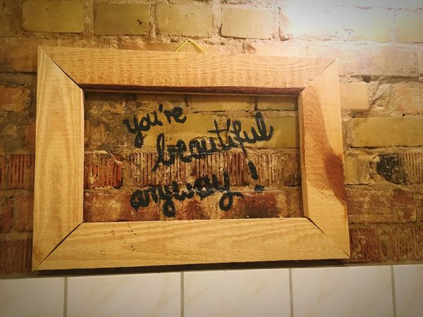 Mirror-Selfie Wooden Frame Brick Wall Stone Wood Written Message Written Words Frame Bathroom You're Beautiful No Mirror Text No People Wall - Building Feature Architecture Art And Craft Indoors  Built Structure Craft Creativity Wood - Material Representation