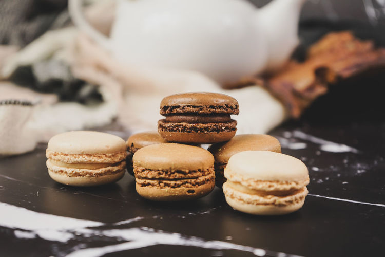 Food And Drink Sweet Food Food Freshness Temptation Indulgence Indoors  Sweet Baked Dessert Unhealthy Eating Ready-to-eat Still Life Close-up Focus On Foreground Selective Focus Chocolate No People Cookie Macaroon Tray French Food Macarons