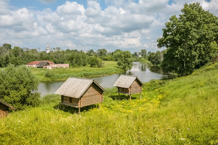 Summer Sunny Day the View of the River, Old Town Countryside, Country, Pond Russia Suzdal Travel Architecture Beauty In Nature Blue Built Structure Day Grass House Landscape Nature No People Outdoors Sanny Sannyday Sky Summer Tree Water