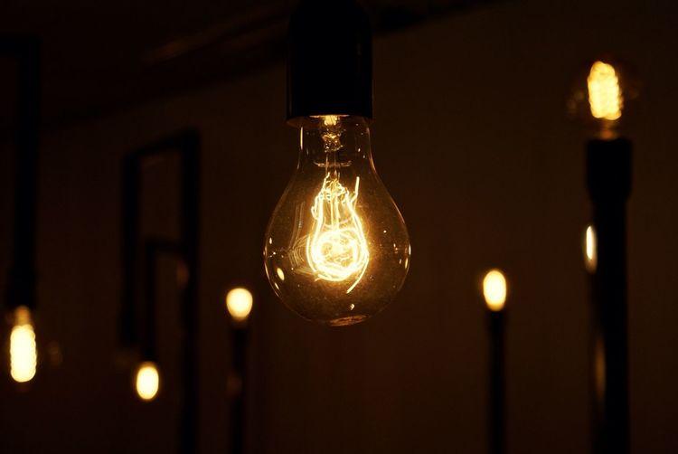 Close-up of lit up light bulb