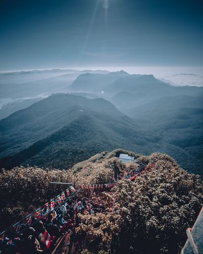 High angle view of crowd on mountain against sky
