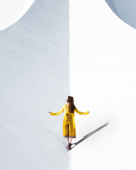 Paint The Town Yellow Only Women One Woman Only One Person One Young Woman Only Adult Young Adult Adults Only Full Length People Young Women Women Leisure Activity Day Outdoors Skill  Agility Architecture