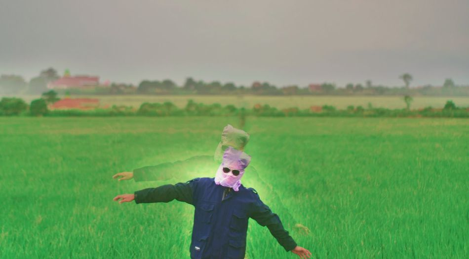 Child Childhood Blond Hair Rural Scene Shouting Protruding Fun Field Vitality Motion Cultivated Land Human Tongue Hood - Clothing Scarecrow Hooded Shirt Farmland Sticking Out Tongue